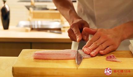 東京推薦高級日本料理店「銀座一」的職人正在切魚